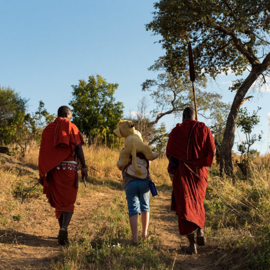Client Walking With Masai