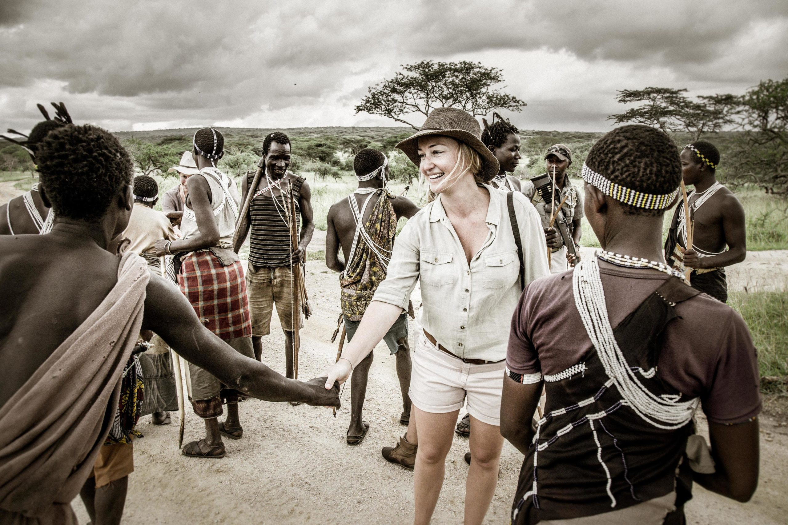 Client shaking hands with tribal people